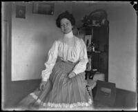 Mertie Whitaker in the parlor of the home of H. H. West, Los Angeles, circa 1900