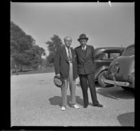 Dr. Bim Smith and H. H. West pose in a parking lot at Norwalk State Hospital, Norwalk, 1943