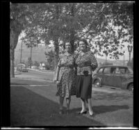 Lydia Kulp and Mrs. George Earl Freeland pose on the Kulp's front lawn, Glendale, 1943