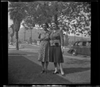 Ludia Kulp and Mrs. George Earl Freeland stand on the Kulp's front lawn, Glendale, 1943