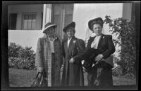Frances Cline Greene, Mertie Whitaker West and France West Wells pose in front of W. W. Witherby's residence, Los Angeles, 1943