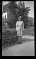 Dorothea Siemsen poses outside her family's home, Glendale, 1943