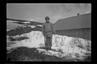 Fellow serviceman of H. H. West, Jr. poses with a rifle in the snow, Dutch Harbor, 1943