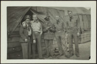 Charles Glenn, H. H. West, Jr., Harold Brown, David Sparks and Herman Schultz pose in front of the barracks (photo, recto), Camp Murray, 1941 or 1942