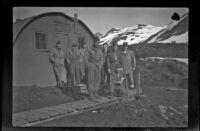 Eight unidentified servicemen pose outside H. H. West, Jr.'s quarters, Dutch Harbor, 1943