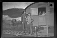 Two servicemen pose in front of H. H. West, Jr.'s quarters, Dutch Harbor, 1943
