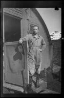 H. H. West, Jr. poses outside his quarters (negative), Dutch Harbor, 1943