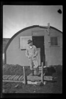H. H. West, Jr. wears his field clothing and poses in front of his barracks, Dutch Harbor, 1943