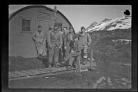 Eight fellow servicemen of H. H. West, Jr.'s pose outside their quarters, Dutch Harbor, 1943