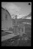 Fellow serviceman of H. H. West, Jr. poses in front of the barracks, Dutch Harbor, 1943