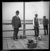 George Corwin and Robert T. Brain stand on the wharf with their fishing gear, Santa Monica, about 1905