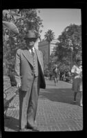 James C. Hanley stands along a walkway in Pershing Square, Los Angeles, 1943