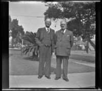 Arthur C. Crowell and J. E. Smith pose together on the front walkway outside J. E. Smith's home, Los Angeles, 1943