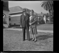 H. H. West and Mertie West pose on the front lawn of their home, Los Angeles, 1944