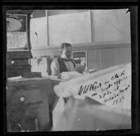 H. H. West sits at his desk in Frank E. Prior's office at the Arcade Depot, Los Angeles, 1898