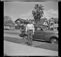 Richard Siemsen poses in front of H. H. West's Buick, Los Angeles, 1944