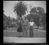 Dorothea (Siemsen) Burgess, Alfred Siemsen and Richard Siemsen pose on the walkway in front of H. H. West's home, Los Angeles, 1944