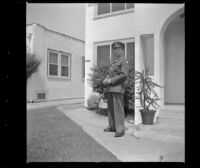 P.F.C. H. H. West, Jr. poses outside the West's new residence, Los Angeles, 1944