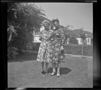 Mertie West and Frances Wells pose on the front lawn of the Siemsen's residence, Glendale, 1944