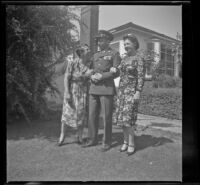 Elizabeth Siemsen, H. H. West, Jr. and Frances Wells pose on the front lawn of the Siemsen's residence, Glendale, 1944