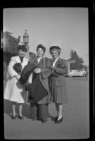 Frances Cline Greene, Frances West Wells and Mertie West pose outside the Glendale Southern Pacific Railroad Depot, Glendale, 1944