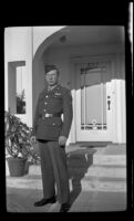 P.F.C. H. H. West, Jr. poses in front of the West's residence while visiting on a 3-day pass, Los Angeles, 1944