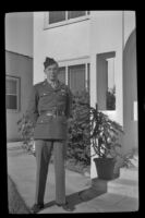 P.F.C. H. H. West, Jr. poses outside the West's residence while visiting on a 3-day pass, Los Angeles, 1944