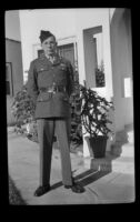 P.F.C. H. H. West, Jr. stands outside the West's residence while visiting on a 3-day pass, Los Angeles, 1944