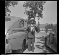 Wayne West poses with the 3 trout he caught, Big Bear Lake, 1944