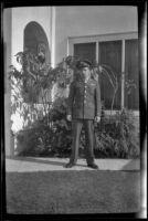 PFC H. H. West, Jr. poses in front of H. H. West's residence, Los Angeles, 1944
