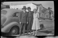 Wayne West, Maud West and Mertie West pose next to Wayne West's car, Los Angeles, 1944