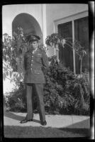 PFC H. H. West, Jr. stands in front of H. H. West's residence, Los Angeles, 1944