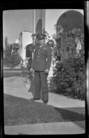 PFC H. H. West, Jr. poses on the walkway in front of H. H. West's residence, Los Angeles, 1944