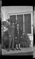 PFC H. H. West, Jr. and Anna Roth pose in front of H. H. West's residence, Los Angeles, 1944