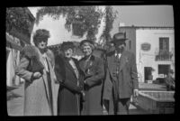 Dode Witherby, Zetta Witherby, Mertie West and H. H. West pose in the courtyard at El Paseo, Santa Barbara, 1945