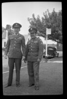 H. H. West, Jr. and Walter Burgess pose on the parkway outside H. H. West's home, Los Angeles, 1945