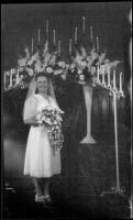 Ann Roth (Mrs. H. H. West, Jr.) poses at the alter on her wedding day, Los Angeles, 1945