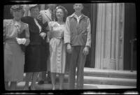 Mrs. H. H. West, Frances West Wells, H. H. West, Jr., Mrs. H. H. West, Jr. and Richard Siemsen pose on the front steps outside a church, Los Angeles, 1946
