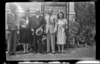 Richard Siemsen, Frances West Wells, H. H. West, H. H. West, Jr. and Mrs. H. H. West, Jr. pose on the lawn outside a church, Los Angeles, 1946