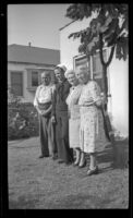 Romayne Shaw, Richard Shaw, Edith Shaw and Josie Shaw pose in the backyard of W. H. and Josie Shaw's home, Los Angeles, 1946