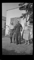 Romayne Shaw, Richard Shaw and Edith Shaw pose in the backyard of W. H. Shaw's home, Los Angeles, 1946