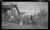 Frances Wells and Mertie West converse with an unidentified woman in her garden, Anchorage, 1946