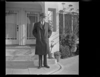 H. H. West poses in front of his home on North Ridgewood Place, Los Angeles, 1947