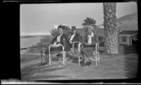 Zetta Witherby, Dode Witherby and Mertie West sit on the veranda at Furnace Creek Inn, Death Valley National Park, 1947