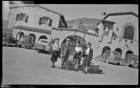 Zetta Witherby, Wes Witherby, Mertie West and Dode Witherby pose in front of Scotty's Castle, Death Valley National Park, 1947