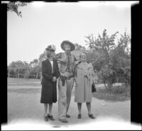 Mertie West and Mrs. D. L. Tribe pose with the Sheriff of Ghost City at Knott's Berry Farm, Buena Park, 1947
