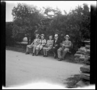 H. H. West, Jr., Anna West, Mrs. D. L. Tribe, Mertie West and D. L. Tribe sit on a bench at Knott's Berry Farm, Buena Park, 1947