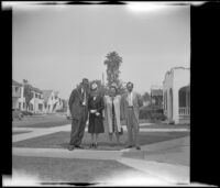 W. L. Kinsell, Mertie West, Anna West and H. H. West, Jr. pose outside H. H. West's residence, Los Angeles, 1947