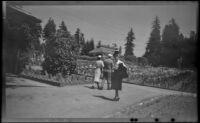 Mertie West standing in the Rose Garden at Stanley Park, Vancouver, 1947