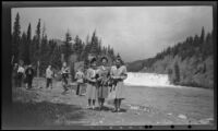 Mertie West and 2 women from Toronto pose in front of Bow Falls, Banff, 1947